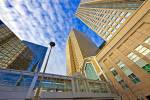 Stock photo of the Twin Towers of the Bankers Hall and a bridge which is part of the Plus 15 Walkway system connecting high-rise buildings and shopping centres in the city of Calgary, Alberta, Canada. Looking up from the street level you see a very tall p