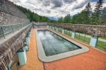Stock photo of the Cave and Basin Pool at the Basin National Historic Site In Sulphur Mountain, Banff National Park, Alberta, Canada.
