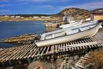 Stock photo of boats hauled out on wooden ramps in St Lunaire-Griquet Harbour, St Lunaire-Griquet, Viking Trail, Highway 436 enroute to L'Anse aux Meadows, Great Northern Peninsula, Northern Peninsula, Newfoundland, Canada.