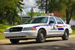 Stock photo of a white Canadian police car of the RCMP Police Academy, City of Regina, Saskatchewan, Canada.