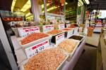 Stock photo displaying rows of authentic Chinese foods, herbs, and spices shelved outside a market in Toronto's Chinatown.