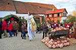 Stock photo of a man on stilts dressed as a fairy, looking for Christmas gifts and interacting with the crowd at the Christmas Markets at Hexenagger Castle, Hexenagger, Bavaria, Germany, Europe.