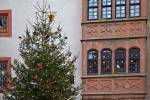 Stock photo of a Christmas tree and decorated windows of a building in the grounds of Burg Ronneburg (Burgmuseum), Ronneburg Castle, Ronneburg, Hessen, Germany, Europe.