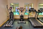 Stock photo of exercise equipment looking at the pool area at the Black Bear Resort & Spa, Port McNeill, Northern Vancouver Island, Vancouver.