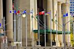 Stock photo of flag poles bearing the provincial and territorial flags of Canada outside the Government Conference Centre in Ottawa.