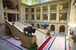 Stock photo of the grand staircase of the Legislative Building flanked on each side by life sized bronze statues of two North American Bison, City of Winnipeg, Manitoba, Canada.
