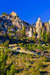 Stock photo of the Ruins of Castell de Guadalest, Castle of Guadalest, and the white washed church belfry in the town of Guadalest, Costa Blanca, Province of Alicante, Comunidad Valenciana, Spain, Europe.
