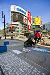 Chalk Artist on Pavement Buildings and Blue Sky in Downtown Toronto Ontario Canada