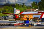 Stock photo of an orange and red Norseman aircraft, operated by Chimo Air Service, in the town of Red Lake, Ontario, Canada.