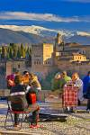 Stock photo of people enjoying the Mirador del San Nicolas in the Albayzin district, with a view of the Alhambra City of Granada, Province of Granada, Andalusia, Spain, Europe. The Alhambra and the Albayzin district are UNESCO World Heritage Sites.