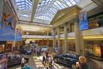 Stock photo of a shopping day at the mall with several people walking to shops at the Cornwall Centre, City of Regina, Saskatchewan, Canada.