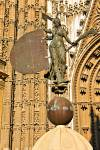 Stock photo of replica of the weather vane, a statue representing Faith outside the Door of the Prince (or San Cristobal), Seville Cathedral and La Giralda (bell tower/minaret), a UNESCO World Heritage Site, Santa Cruz District, City of Sevilla (Seville),