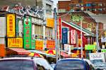 Stock photo of colorful street signs along a road in Toronto's Chinatown, Ontario.