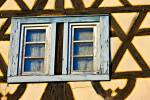 Stock photo of windows of an old building in the town of Michelstadt, Hessen, Germany, Europe.