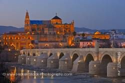Puente Romano spans Rio Guadalquivir leads to Mezquita during dusk in City of Cordoba