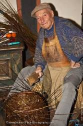 Elderly man weaving branches medieval markets castle Ronneburg