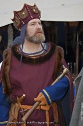 King dressed medieval clothing