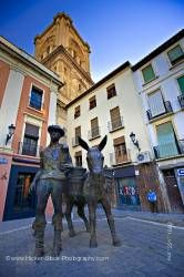 Man and donkey statue Plaza de la Romanilla and bell tower of Cathedral City of Granada