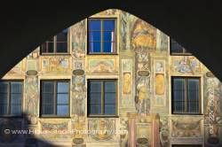 Murals painted on facade of building in Old Town district in City of Landshut Bavaria Germany