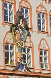 Religious motif on facade of building in Old Town district in City of Landshut Bavaria Germany