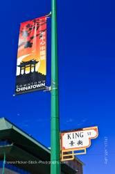 Banner and Street Sign in Chinatown in the City of Winnipeg in Manitoba Canada Blue Sky