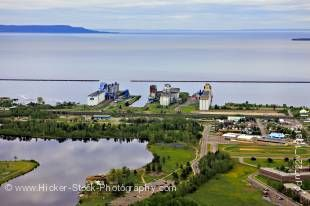 Stock photo aerial view showing Boulevard Lake in the Current River Greenway and Grain Elevators lining the waterfront of Lake Superior in the City of Thunder Bay, Ontario, Canada.