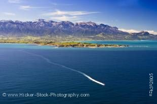 Stock photo of aerial view of the Kaikoura Peninsula and a whale watching boat during a Whale Watching flight with Wings over Whales, Kaikoura, East Coast, South Island, New Zealand.