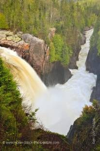 Stock photo of the rushing waters of Aquasabon Falls during a Spring flood, near the town of Terrace Bay, Ontario, Canada.