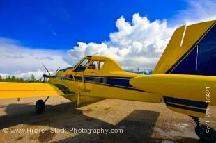 Stock photo of a bright yellow bush plane, an Air tractor AT-802, modified for bulk fuel hauling (capacity 4,000 litres) in Red Lake, Ontario, Canada.