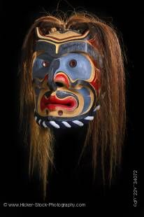 Stock photo of a work of art, a wooden Bakwas mask by Don Svanvik, Kwakwaka'wakw First Nations artist, original West Coast native art, on display at Just Art Gallery, Port McNeill, Northern Vancouver Island, British Columbia, Canada.