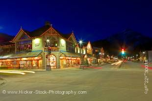 Stock photo of a nighttime street scene in winter, looking north from the corner of Banff Avenue and Caribou Street towards Cascade Mountain at night in the Town of Banff, Banff National Park, Canadian Rocky Mountains, Alberta, Canada.