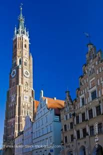 Stock photo of bell tower of Martinskirche (St Martin's Church) and the unique facades of buildings in the Old Town district in the City of Landshut, Bavaria, Germany, Europe.