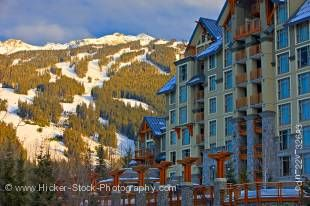 Stock photo of Blackcomb Mountain and the Pan Pacific Hotel seen from along the Village Stroll, Whistler Village, British Columbia, Canada.