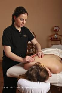 Stock photo of a masseuse providing a relaxing body massage for a woman at the Black Bear Resort & Spa in Port McNeill, Northern Vancouver Island, Vancouver Island, British Columbia, Canada.