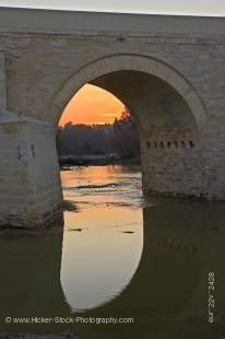 Stock photo of Puente Romano (bridge) spanning the Rio Guadalquivir (river) at sunset in the City of Cordoba, UNESCO World Heritage Site, Province of Cordoba, Andalusia (Andalucia), Spain, Europe.