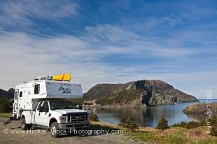Stock photo of a camper parked an open area in Bottle Cove at the end of the Humber Arm near Lark Harbour, Newfoundland, Canada.