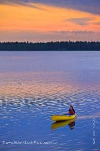 Stock photo of canoeing on Lake Audy, Riding Mountain National Park.