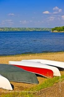 Stock photo of canoes on the sandy beach of Echo Lake in Echo Valley Provincial Park, Qu'Appelle Valley, Saskatchewan, Canada.