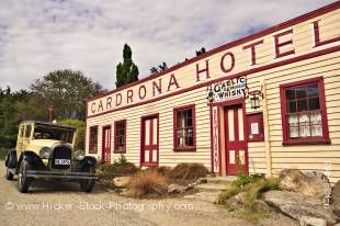 Stock photo of the historic Cardrona Hotel (est. 1863) with an old vintage Chrysler car parked outside, Crown Range Road, Central Otago, South Island, New Zealand