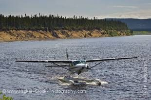 Stock photo of a Cessna Caravan amphibian airplane landing on Eagle River at Rifflin' Hitch Lodge in Southern Labrador, Labrador, Newfoundland Labrador, Canada.