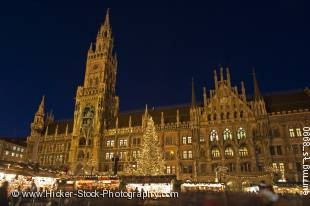 Stock photo of Christkindlmarkt (Christmas Markets) in the Marienplatz outside the Neues Rathaus (New City Hall) at dusk in the City of MŸnchen (Munich), Bavaria, Germany, Europe.