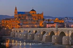 Stock photo of the Puente Romano (bridge) spanning the Rio Guadalquivir (river) and the Mezquita (Cathedral-Mosque) during dusk in the City of Cordoba, UNESCO World Heritage Site, Province of Cordoba, Andalusia (Andalucia), Spain, Europe.