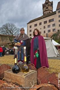 Stock photo of couple dressed in medieval clothing at the medieval markets on the grounds of Burg Ronneburg (Burgmuseum), Ronneburg Castle, Ronneburg, Hessen, Germany, Europe.