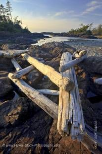 Stock photo of driftwood strewn over a rocky outcrop along South Beach, Pacific Rim National Park, Long Beach Unit, Clayoquot Sound UNESCO Biosphere Reserve, West Coast, Pacific Ocean, Vancouver Island, British Columbia, Canada.