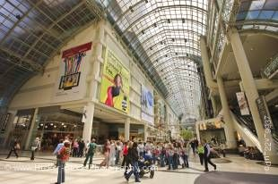 Stock photo of the busy interior of the Eaton Centre shopping complex in downtown Toronto in Ontario, Canada.