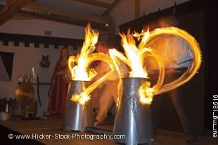 Stock photo of entertainers using drumsticks lit by fire to beat the drums and entertain guests during a medieval feast at Schloss Auerbach (Auerbach Castle), Bensheim-Auerbach, Hessen, Germany, Europe.