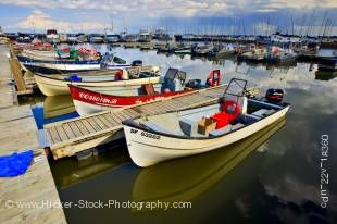 Stock photo of endless fishing boats the Main Dock Boat Harbour on the shores of Lake Winnipeg in the town of Gimli, Manitoba, Canada.
