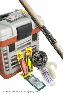 Stock photo of fishing box with fishing gear.