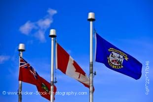 Stock photo of the flags of Red Lake, Ontario, and Canada on flagpoles at Norseman Heritage Centre Park in the town of Red Lake, Ontario, Canada.
