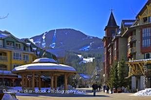 Stock photo of the gazebo in the Town Plaza along the Village Stroll with Whistler Mountain and a clear blue sky in the background, Whistler Village, British Columbia, Canada.